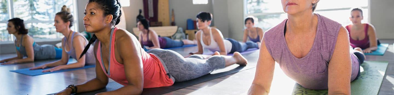 person with rheumatoid arthritis doing yoga